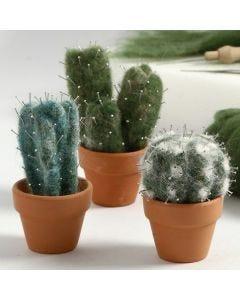 Nålefiltet kaktus av kardet ull med knappenåler som pigger