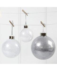 Glasskuler fylt med glitter