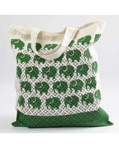 Mulepose med trykk og tegnede mønstre etter stensil