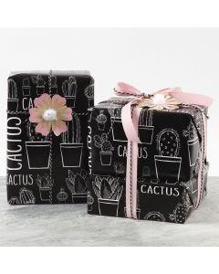 Gaveinnpakning pyntet med blomst av kartong