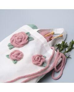 Mulepose pyntet med roser laget av tubestrikk