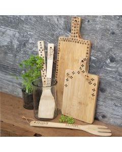 Kjøkkenredskaper av bambus dekorert med sviapparat