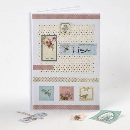 Decoupagestickers og designpapir på omslaget av hvit kinabok