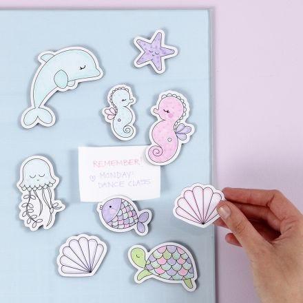 Havdyr-magneter dekorert med tusj