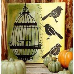 Lerret med fugler og bur