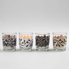 Lysglass med utstanset, preget og trykt bord av papir