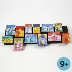 Lerreter med byhus som collage på trelist