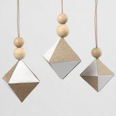 Hvitt diamant-oppheng med felt av glitrende kobberpapir
