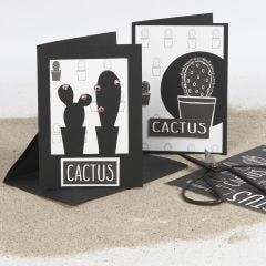 Dobbeltkort dekorert med utskjæring og designpapir