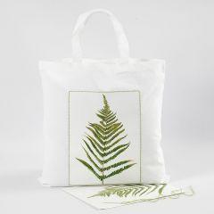 Mulepose med bladprint og brodert kant.