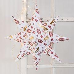 Stor julestjerne brettet i designpapir med nøtteknekker som motiv