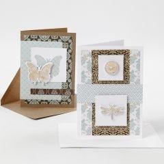 Kort pyntet med designpapir og utstansede motiver med dekorasjonsfolie