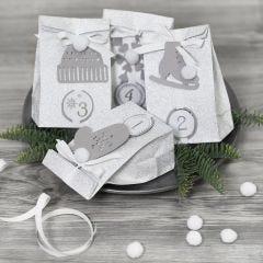 Adventsgaver pyntet med papirklipp og pomponer