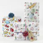 Innpakning med gavepapir, garn og pynt