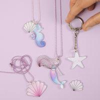 Havfrue og havdyr-smykker og nøkkelring av krympeplast