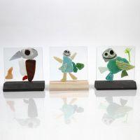 Glassplater med mosaikk og porselenstusj