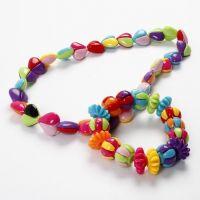 Armbånd og halskjede med todelte perler