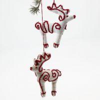 Ferdigsydd reinsdyr i tekstil med enkelt broderi