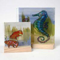 Akvarium på todelt 3D-plate av tre og glass