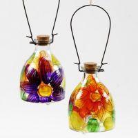 Vepsefanger av glass med malt blomstermotiv