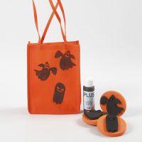 Orange pose til Halloween dekorert med motiver
