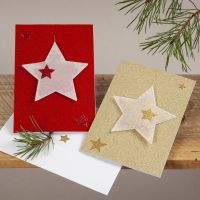 Julekort i glitter med stjerneoppheng av pergamentpapir