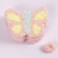 Eske formet som sommerfugl dekorert med Pearl Clay