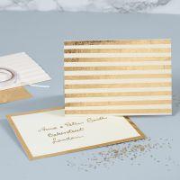 Perlemorskort pyntet med gullstriper av dekorasjonsfolie