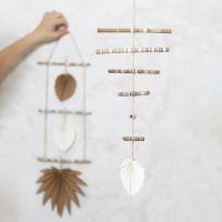 Uro av pyntede bambuspinner og lærpapir